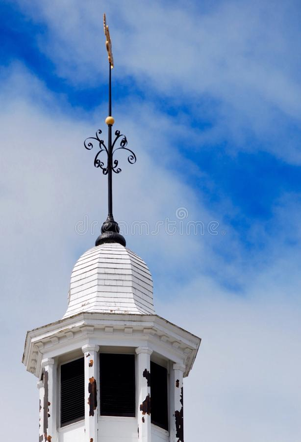 White, round steeple with gold fish weathervane on top stock photo