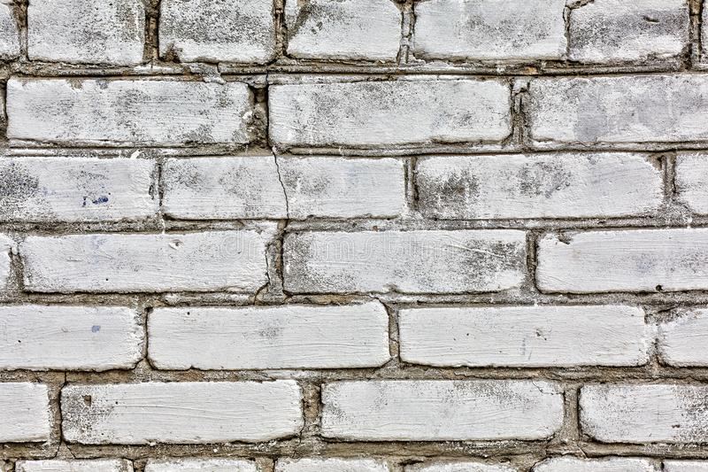 White Rustic Texture. Retro Whitewashed Old Brick Wall Surface. Vintage Structure. Grungy Shabby Uneven Painted Plaster. Whiten Fa royalty free stock photography