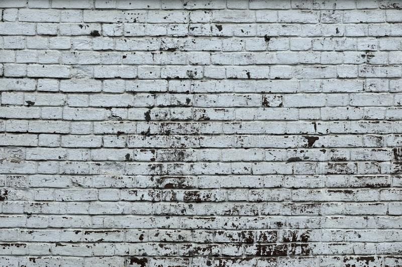 White Rustic Texture. Retro Whitewashed Old Brick Wall Surface. Vintage Structure. Grungy Shabby Uneven Painted Plaster. Whiten royalty free stock photography