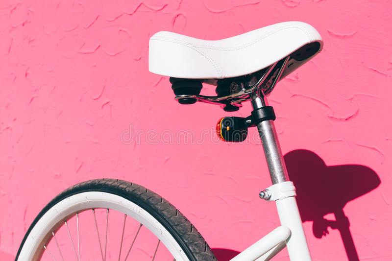 White saddle of a female city bicycle against a background of a royalty free stock images