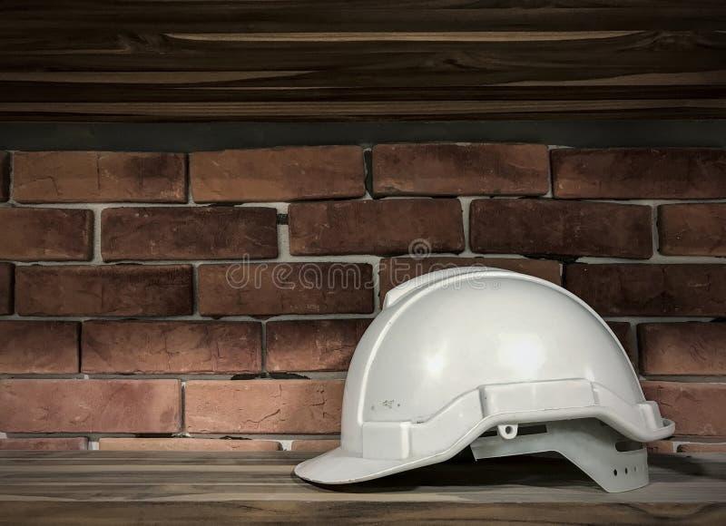 White safety helmet on wood floor royalty free stock image