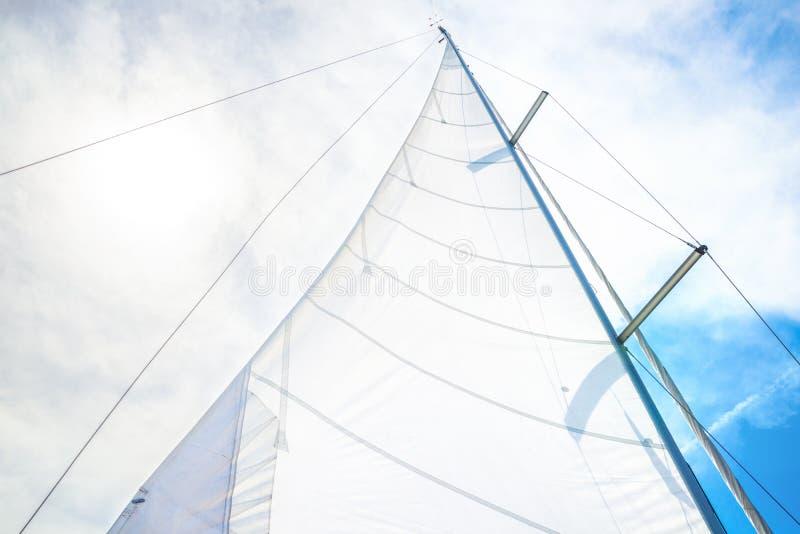 White sail. Against blue sky stock photos