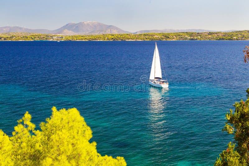 White sail and  blue  sea stock photo