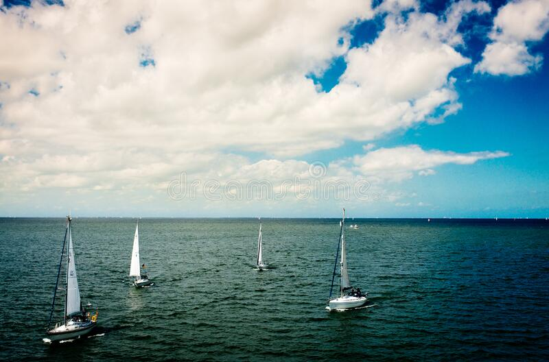 White Sail Boat On Body Of Water Under Blue Cloudy Sky During Daytime Free Public Domain Cc0 Image