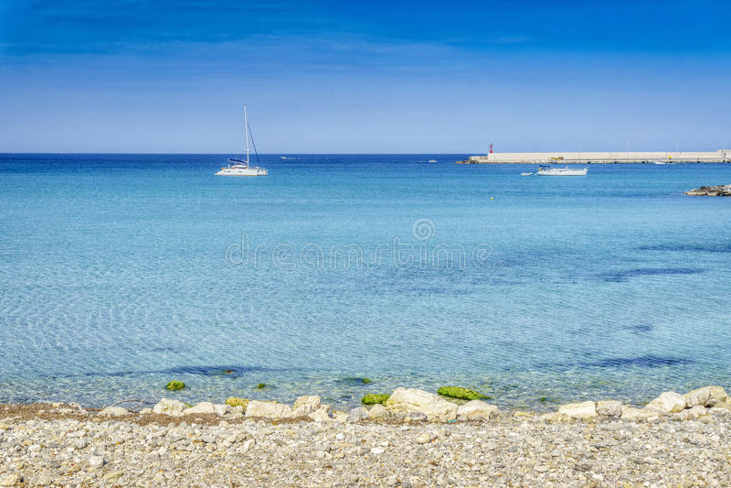White sail boats at Otranto coast, Italy. White sail boats at Otranto coast, Apulia, Italy royalty free stock image