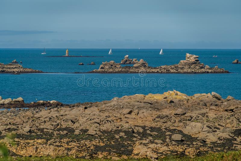 White sail boats sailing in Brittany France stock image