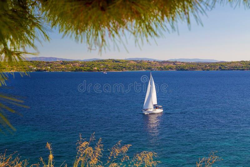 White sail near Greek island. N Majestic sunny morning stock images