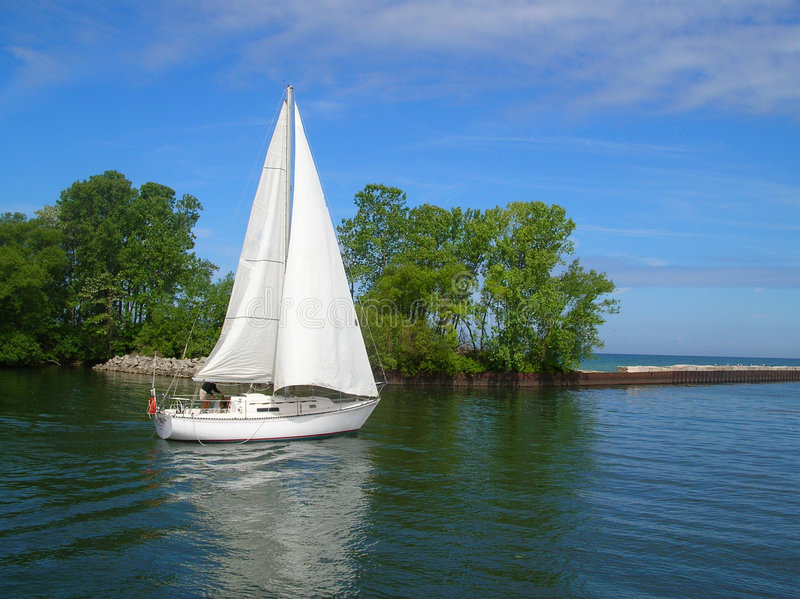 White Sailboat stock images