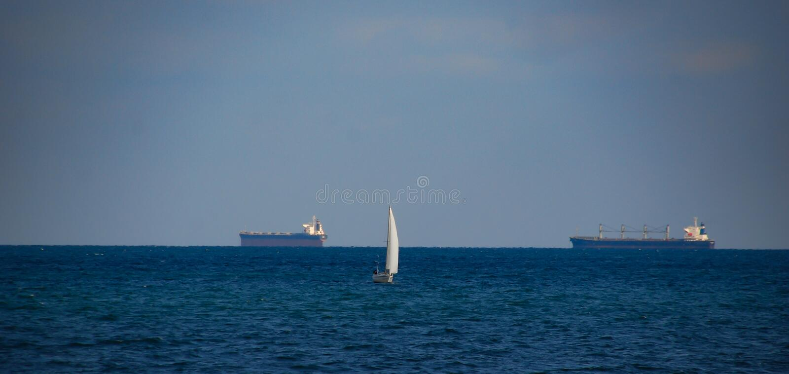 White sailboat on the background of the Black Sea stock photos