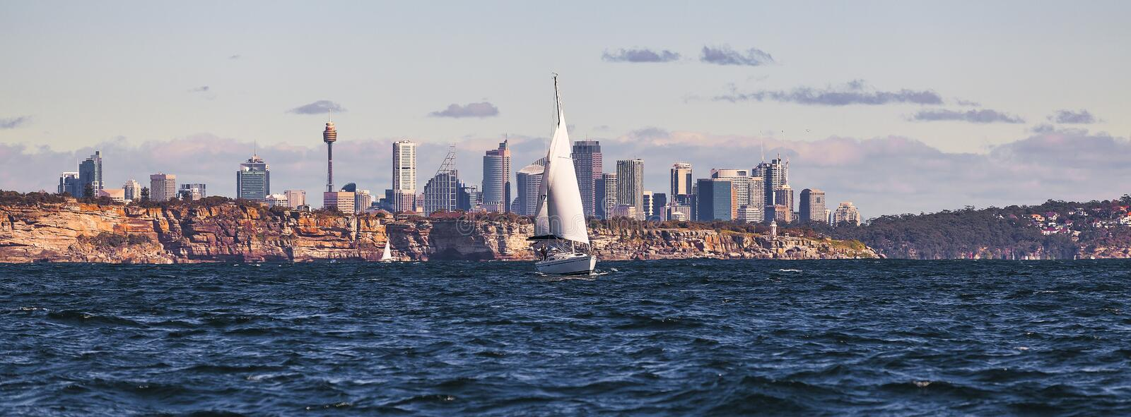 White Sailboat on Body of Water Near City stock images