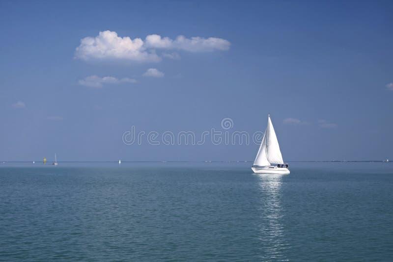 White sailboat on Lake Balaton royalty free stock image