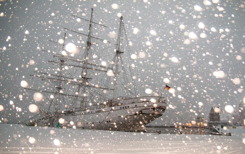 White Sailing Ship Docked at Pier stock images