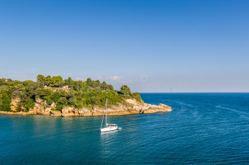White sailing yacht in the bay of Adriatic sea. White sailing yacht in a beautiful bay of Adriatic sea. Ulcinj, Montenegro royalty free stock photography