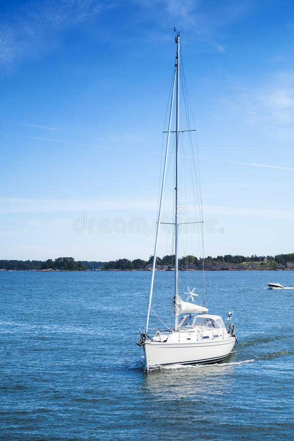 White sailing yacht in Gulf of Finland stock photos
