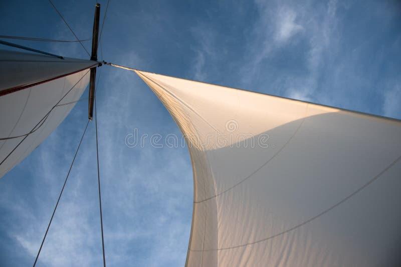 White sails against blue sky stock photos