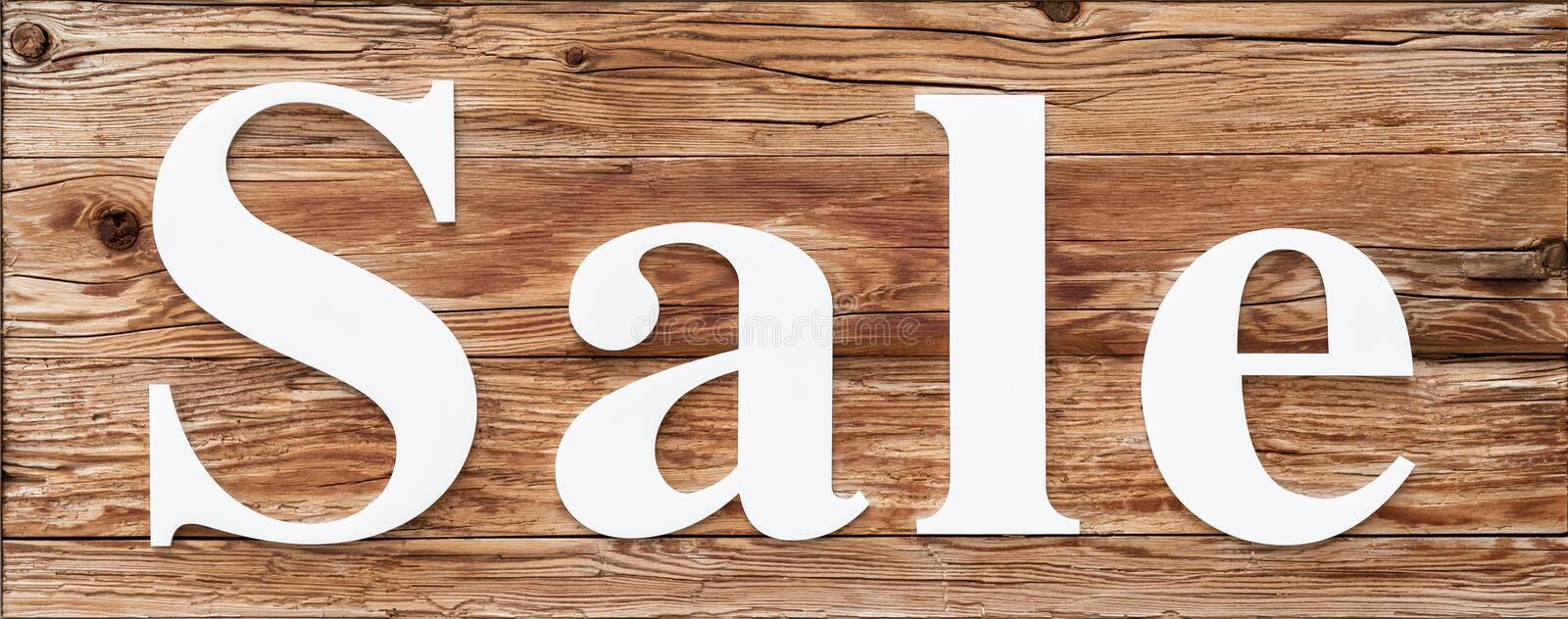 White sale word on wooden signboard isolated. Seasonal discount promotions and offers. stock photos