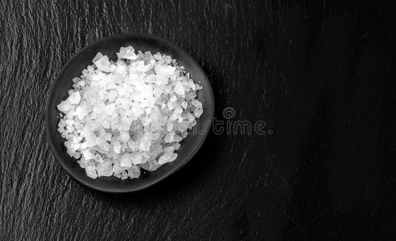 White salt on black royalty free stock photos