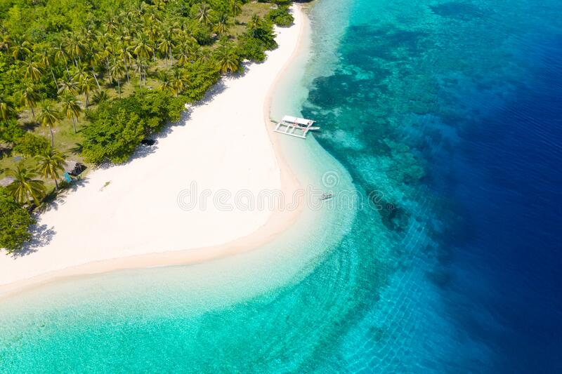 White sand beach and blue sea, view from above . Mahaba Island, Philippines. advertising concept. White sand beach and blue sea. view from above. Mahaba Island stock photo