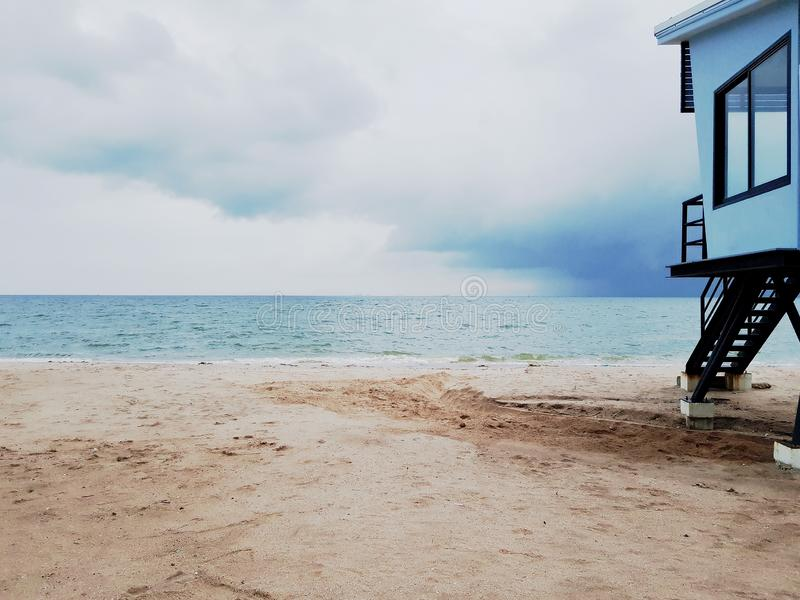 White sand beach in a cloudy day stock photography