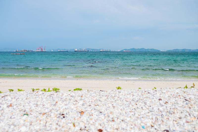 White sand beach, island and beautiful sea on the day of bright skies royalty free stock images