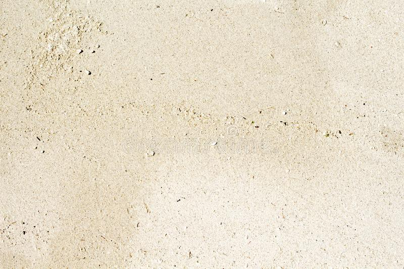 White sand beach top view photo. Smooth coral sand texture. Seaside wanderlust banner template with text place. Seashore sand background. Empty unmarked beach stock photography