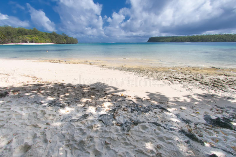 White Sand Beach On Turquoise Tropical Paradise Lagoon Stock Images