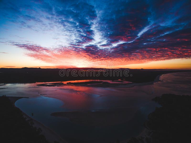 White Sand Beach Under Cloudy Sky during Sunset stock images