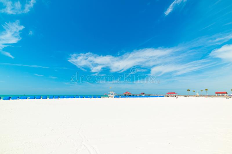 White sand in Clearwater beach. Florida, USA, tampa, tropical, united, states, america, man, person, people, tropics, palm, tree, beautiful, blue, island, sea stock image