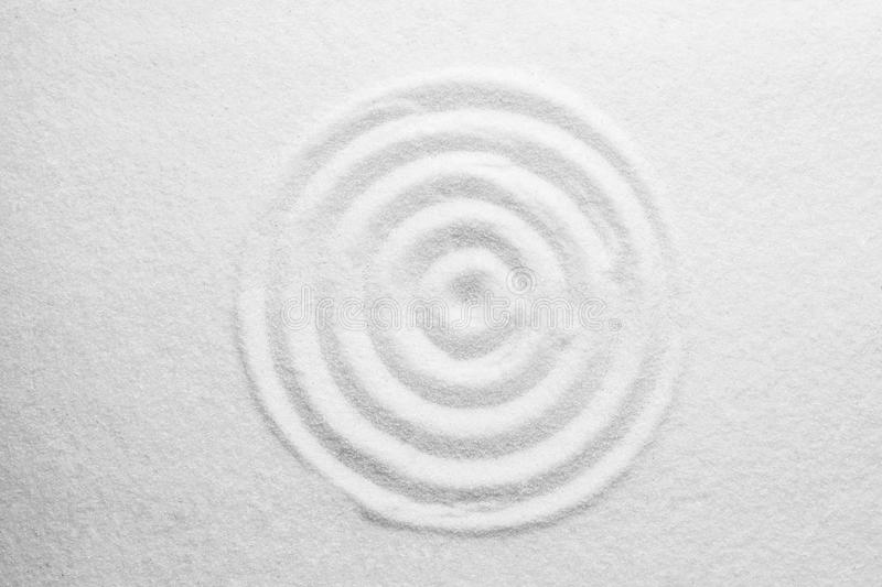 White sand with pattern as background, top view. Zen, meditation, harmony. White sand with pattern as background, top view. Zen, meditation stock images