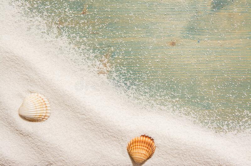 White sand and and shells on  planked wood. Summer background with copy space. Top view. White sand and and shells on planked wood. Summer background with copy stock photos