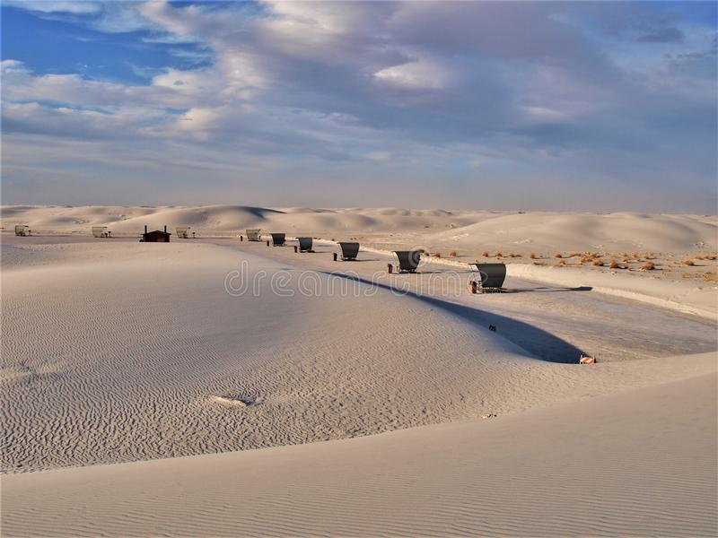 White Sands National Monument Picnic Tables. White Sands National Monument is located in southern New Mexico. Wave-like ripples of glistening gypsum sand creates royalty free stock image