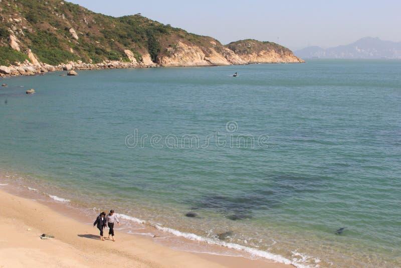 Couple at white sandy beach at Cheung Chau Island, Hongkong stock image
