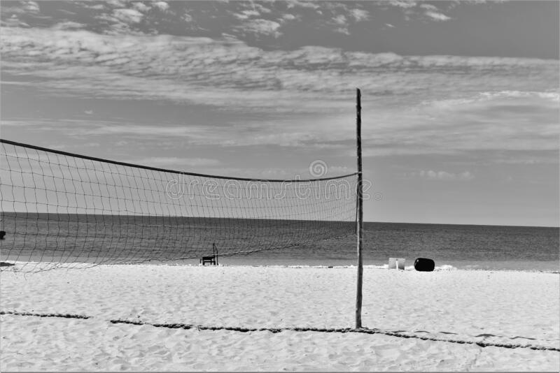 Volley ball net on a white sandy beach royalty free stock photos