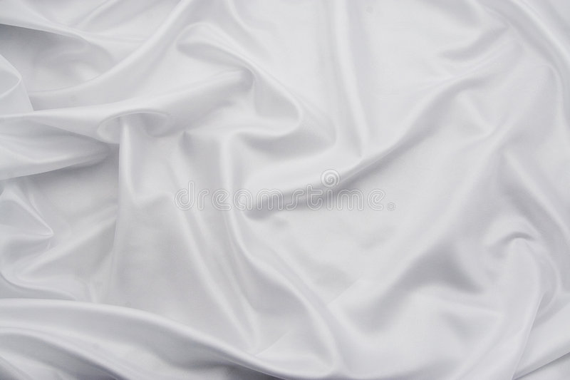 White Satin/Silk Fabric 3. Luxurious white satin/silk folded fabric, useful for backgrounds stock image