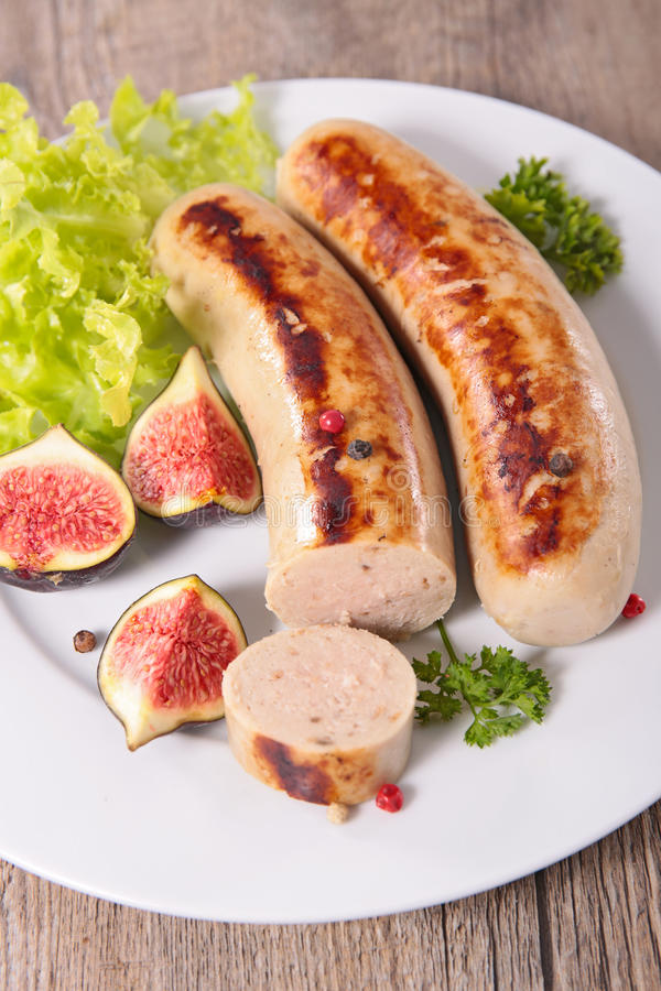 White sausage with fresh fig. Close up on white sausage with fresh fig royalty free stock photos