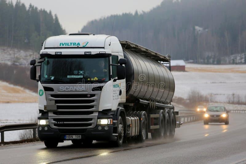 White Scania R440 Semi Tanker in Winter Fog. SALO, FINLAND - DECEMBER 16, 2016: White Scania R440 semi tank truck of Iviltra transports goods along wet asphalt royalty free stock image