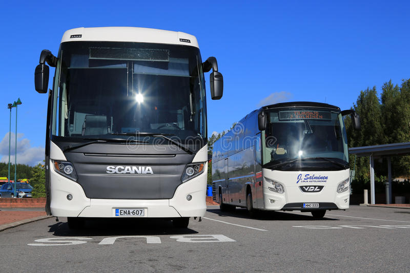 White Scania Touring and VDL Futura Coach Buses stock photos