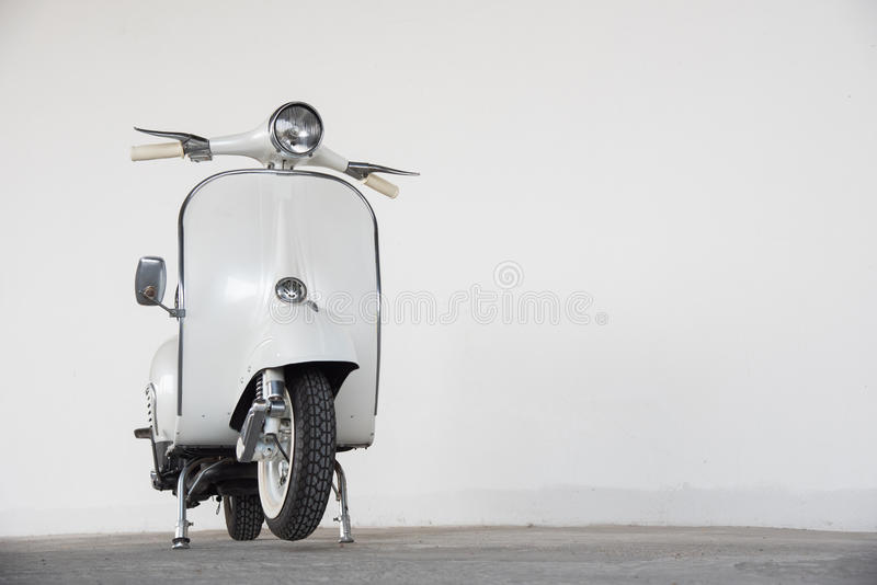White scooter. 1964 scooter vespa made in italy stock photos