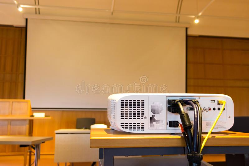 White screen projector in front of a screen stock photos