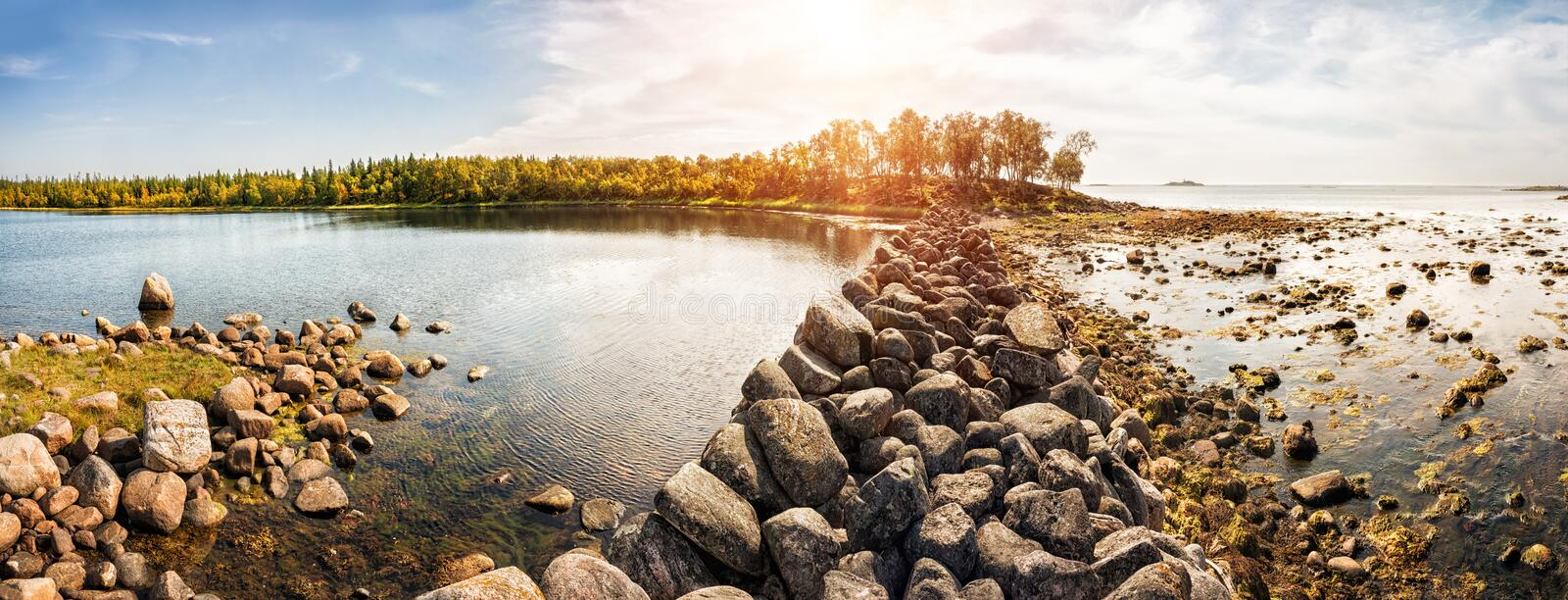White Sea and Filippovskiy cages. With a stone dam for fishing stock photos