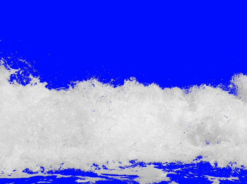 White sea foam from the surf, isolated on a bright royal blue background. The concept of summer vacations, texture of sparkling water stock photography