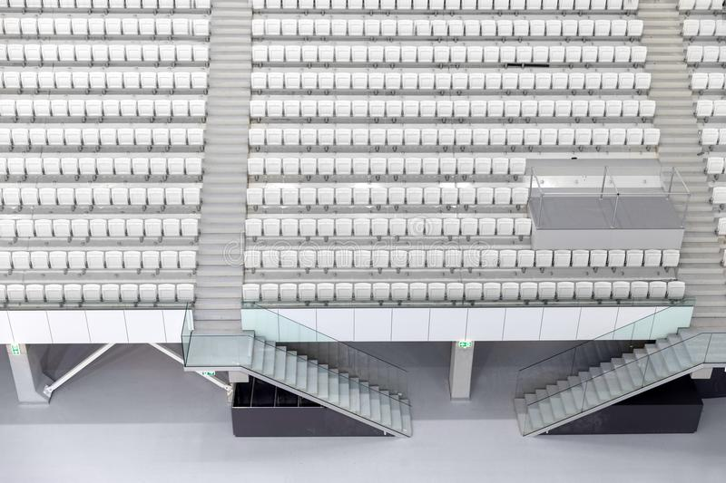 White seats in the large stadium royalty free stock photography