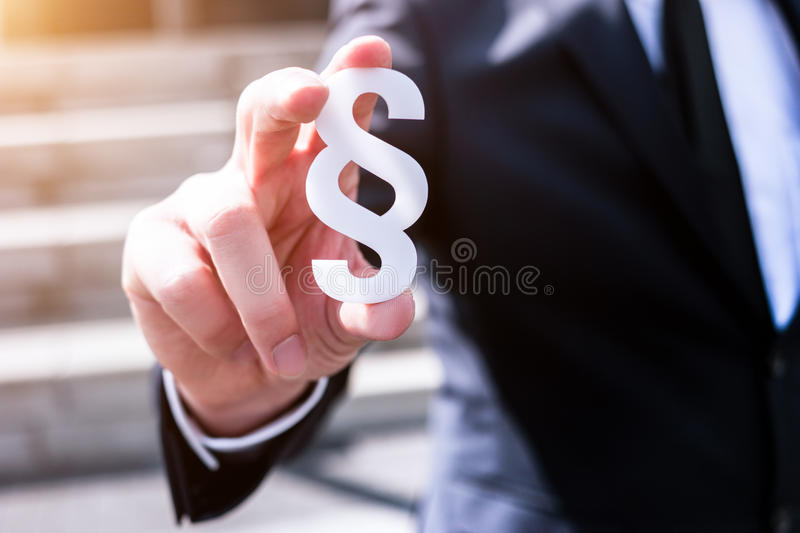 White section sign hold by business man stock images