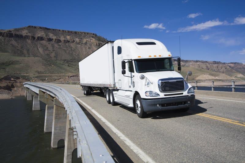White Semi driving the bridge royalty free stock photos