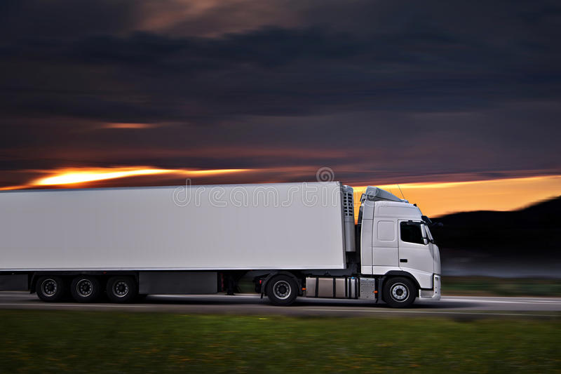 White semi truck on the road stock photos