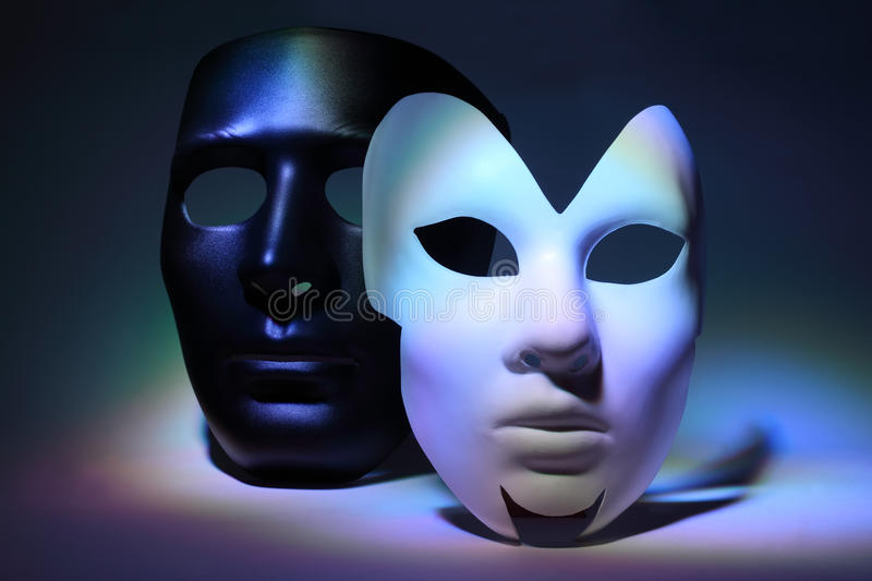 White serious mask and black mask. Simple white serious mask and black mask, which is colorful highlighted royalty free stock photo