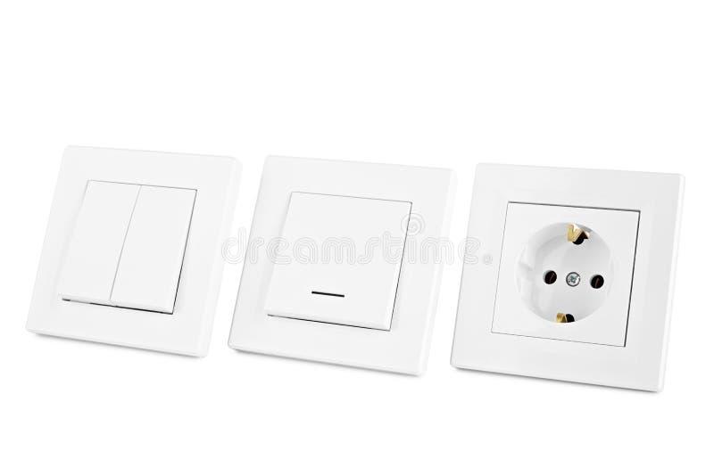 european power sockets on a white wall stock photo