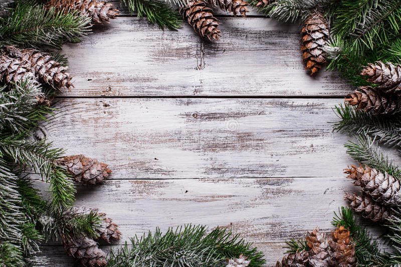White shabby Christmas border. With snow covered pinecones royalty free stock photo