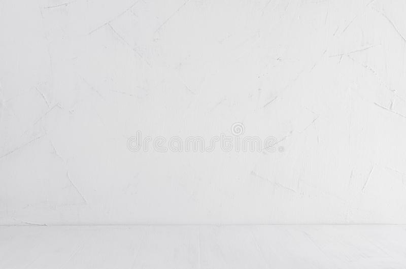White shabby plaster wall and white wood board. Empty shelf, interior. royalty free stock photo