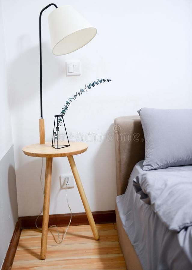 White Shade Table Lamp Near Bed stock photography